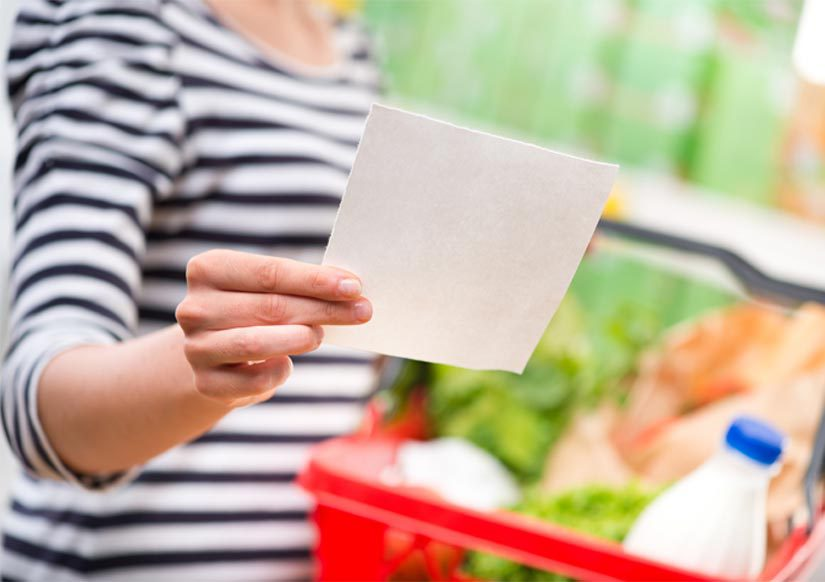 Woman in supermarket with list from Symply