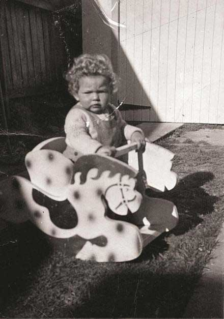 Baby Annette on rocking horse